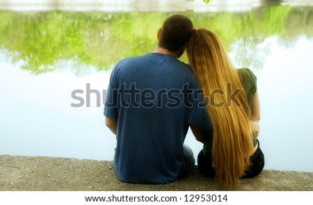 Love and Valentine concept. Back of couple hugging outdoors - stock photo