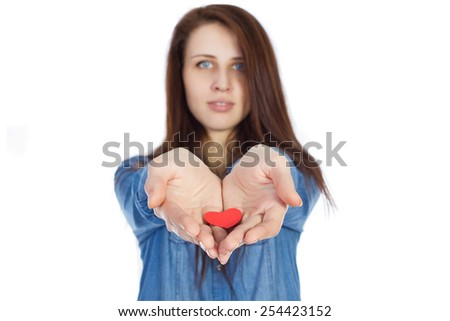 Love and Valentine's Day brunette girl, holding a heart in hands cute and adorable, isolated on white background - stock photo