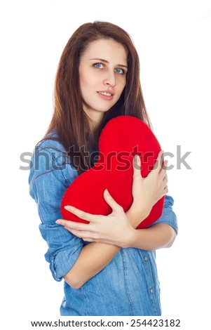 Love and Valentine's Day brunette girl with dimples, holding a heart cute and adorable smile isolated on white background - stock photo