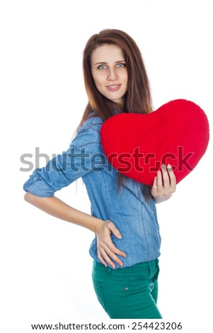 Love and Valentine's Day brunette woman with dimples, holding a heart cute and adorable smile isolated on white background - stock photo