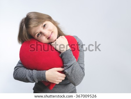 Love and valentines day woman holding heart smiling cute and adorable - stock photo