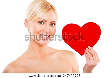 Love and valentines day woman holding heart smiling cute and adorable isolated on white background. Beautiful blonde woman in love - stock photo