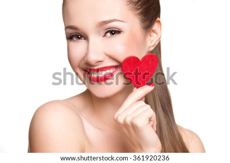 Love and valentines day woman holding heart smiling cute. Portrait of Beautiful woman with bright makeup and red heart in hand - stock photo