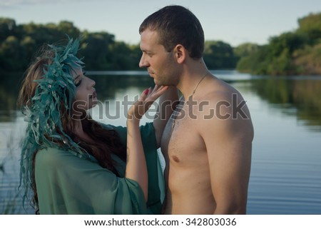 Love between handsome men and beautiful mermaid - stock photo