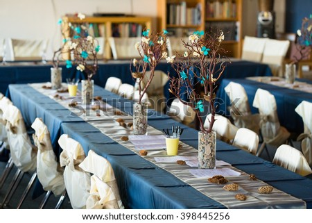 Love bird theme used in the wedding reception decorations features branches and birds.