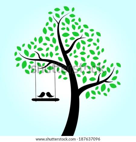 Love birds swinging in tree - stock photo