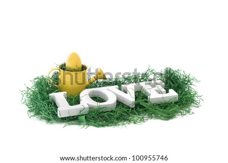 Love concept image with two bunnies and white wooden letters - stock photo