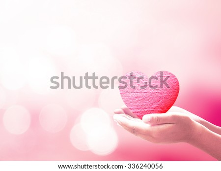 Love concept. Red, Abstract, Bokeh, Woman, Breast, Ovarian, Health Care, Medicine, Insurance, World Cancer Day, Blood Donor, God, Help, Life, Live, Gift, Birth Family. - stock photo