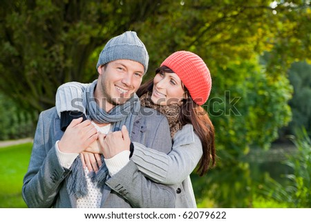 love couple embracing and loving in season - stock photo