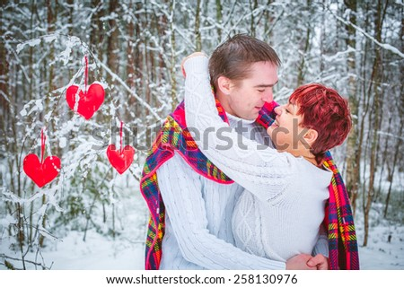 Love couple in a winter woods