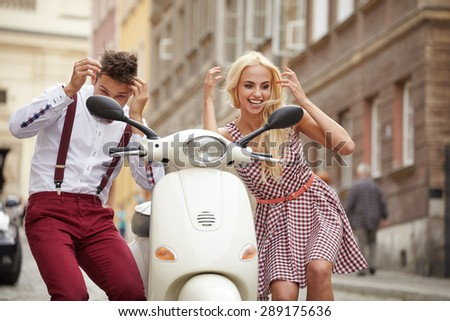Love couple on the street with retro scooter - stock photo