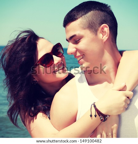 love couple resting on the sea. stylish portrait outdoors - stock photo