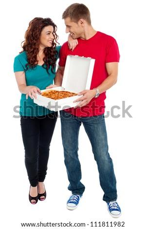 Love couple sharing pizza. Enjoying together. Full length shots - stock photo