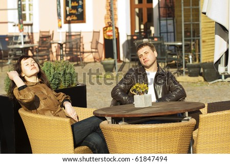 love couple sitting at a table in a cafe - stock photo