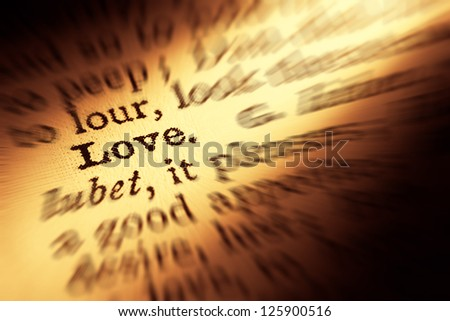 Love definition in dictionary. Motion effect. - stock photo