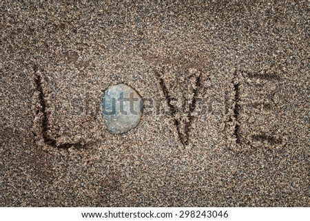 LOVE drawing in the sand on the beach - stock photo