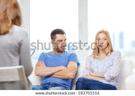 love, family, phychology and relationship problems concept - young couple with a problem at psychologist office - stock photo