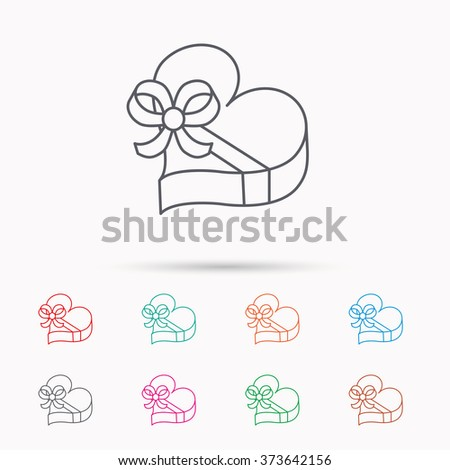 Love gift box icon. Heart with bow sign. Linear icons on white background. - stock photo
