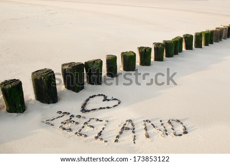 Love heart at the beach of zeeland in Holland - stock photo