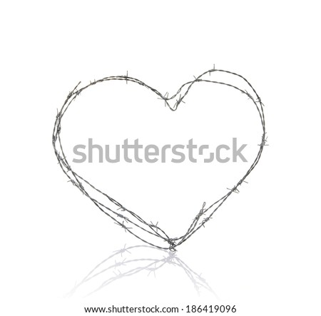 love heart made of barbed wire on white background - stock photo