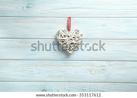 Love heart on a blue wooden background