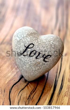 Love - heart on wood - stock photo