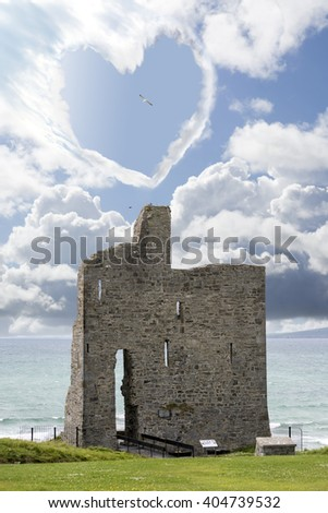 love heart shaped cloud above ballybunion castle in county kerry ireland - stock photo