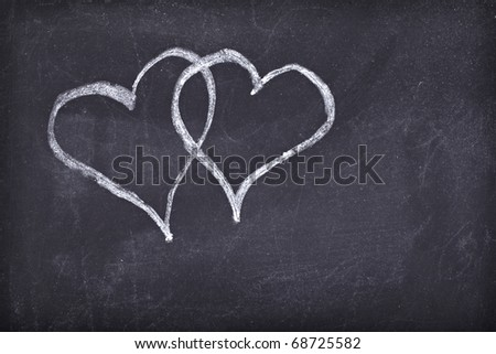 love hearts drawing on a school chalkboard - stock photo