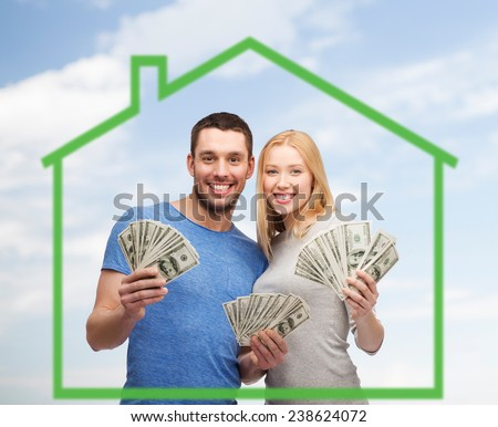 love, home, people and family concept - smiling couple holding dollar cash money over green house and blue sky background - stock photo