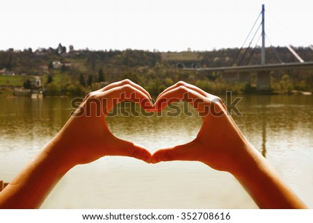Love in nature with a hand's heart - stock photo