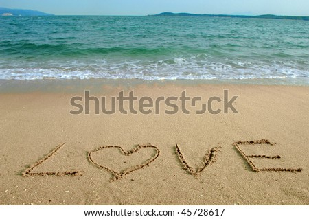Love in the sand - stock photo