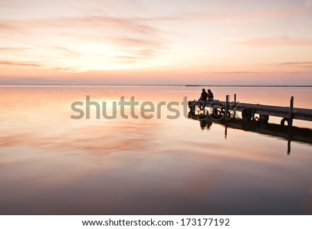 love in the sea at sunset - stock photo