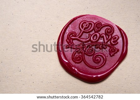 Love letter and ornament on red wax seal over brown paper  - stock photo
