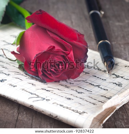 Love letter and rose close up - stock photo