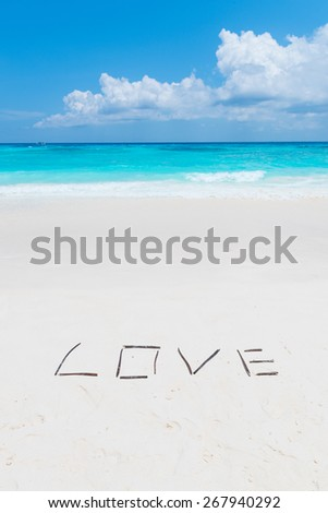 LOVE letter on the white sand beach. - stock photo