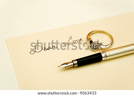 love letter with diamond ring and gold pen