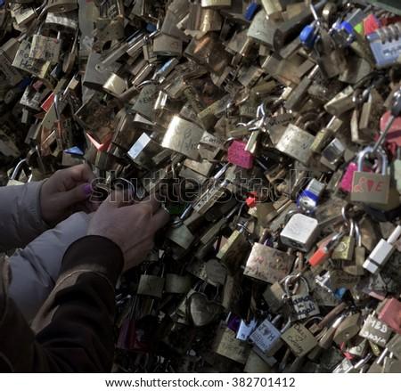 Love locks at the Pont des Arts - stock photo