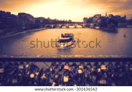 Love locks bridge in Paris. Blurred dark toned photo.  - stock photo