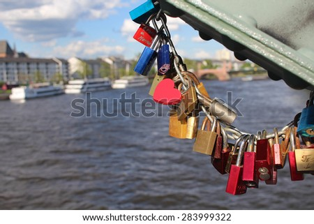 Love locks on a bridge - stock photo