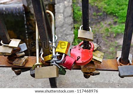 Love locks on bridge in Riga in the Bastion Hill park - stock photo
