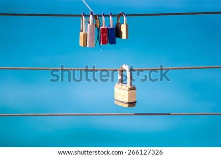 Love locks on sling - stock photo