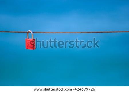 Love locks on sling, copyspace - stock photo