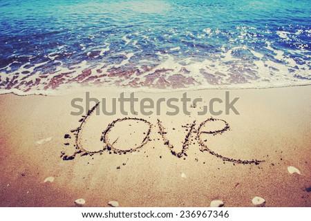 love message written in sand - stock photo