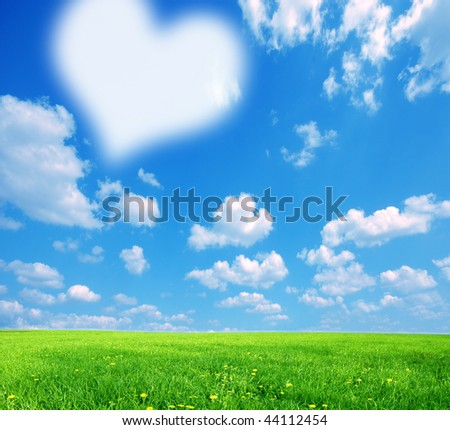 Love nature background, with big white symbolic heart on sky - stock photo