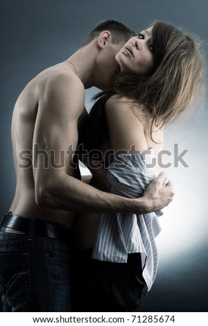 Love of a couple in a passionate open arms. - stock photo