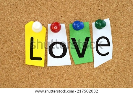 Love on colored sticky notes on a cork board - stock photo