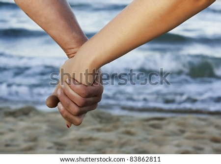 Love on the beach. Love concept. Hand to hand love. Couple on beach.