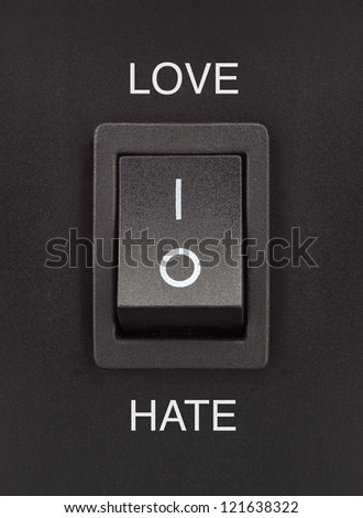 Love or Hate black toggle switch on black surface positive negative