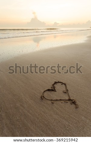 love or heart drawn on the beach during sunset background.  - stock photo