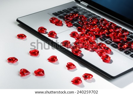 Love or online internet dating concept heart shape symbol on laptop keyboard - stock photo